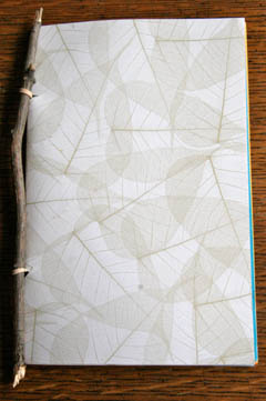 Book made with twig, patterned leaf paper, rubber band